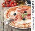 Itaditional pizza with mozzarella, ham and basil, selective focus and square image - stock photo