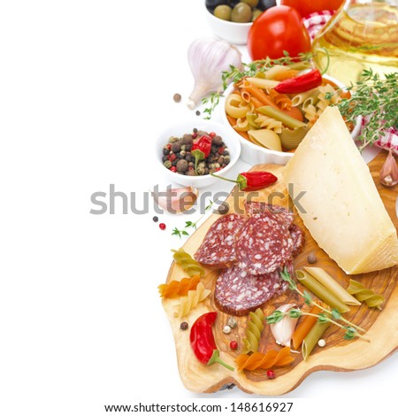Italian appetizers - cheese, sausage, pasta, spices, tomatoes, isolated on white