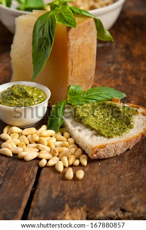 Italian basil pesto bruschetta ingredients over old wood macro