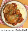 Italian casseroled pork chops served with mashed potatoes. - stock photo