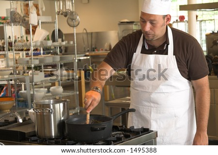 Italian chef stirring in the sauce on the stove