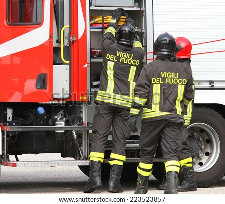 Italian firefighters working near the fire truck when handling an emergency