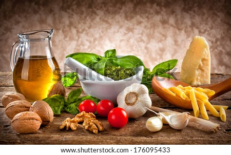 Italian pesto ingredients on wooden table
