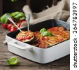 Italian traditional dish parmigiana with eggplant, selective focus and square image - stock photo