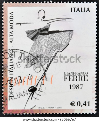 ITALY - CIRCA 1987: A stamp printed in Italy dedicated to italian design shows high fashion by Gianfranco Ferre, circa 1987