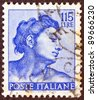 "ITALY - CIRCA 1961: A stamp printed in Italy from the ""Michelangelo"" issue shows a head of the ""Ignudi"" from Sistine Chapel, circa 1961. - stock photo"