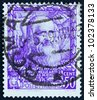 ITALY - CIRCA 1938: a stamp printed in the Italy shows Leonardo da Vinci, inventor, scientist, Proclamation of Italian Empire, circa 1938 - stock photo