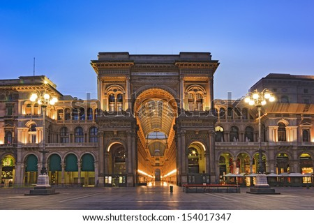 Italy milan city landmark galleria vittorio emanuele first shopping mall in the world richly ornamented building at sunrise with illuminated lights