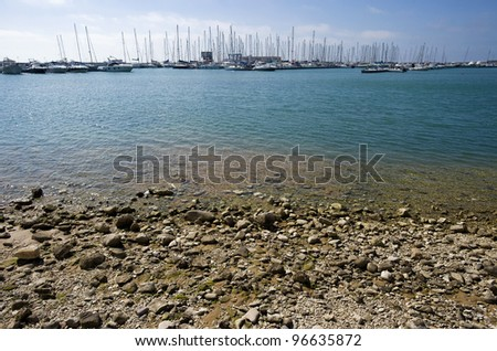 Italy, Siciliy, Mediterranean sea, Marina di Ragusa, view of a beach and boats in the marina