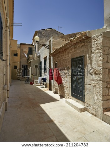 Italy, Sicily, Mediterranean sea, Sampieri (Ragusa Province), old stone houses on the seafront
