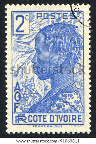 IVORY COAST CIRCA 1936: A stamp printed by Ivory Coast, shows Baoule Woman, circa 1936