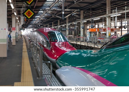 Iwate,Japan - April 27,2014 : The green E5 Series and the red E6 Series Shinkansen bullet train at Kitakami station.