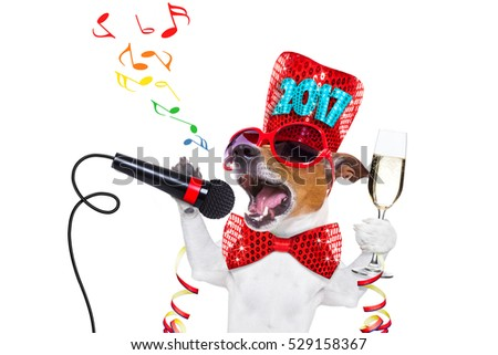 jack russell dog celebrating 2017 new years eve with champagne  glass and singing out loud, with microphone isolated on white background