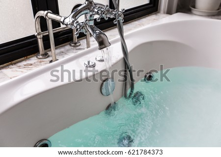 jacuzzi bath. jacuzzi bath tub with water Jacuzzi Bath Tub On Marble Floor Stock Photo 626040152  Shutterstock