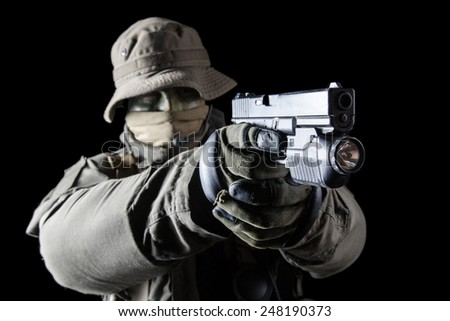 Jagdkommando soldier Austrian special forces with pistol on dark background