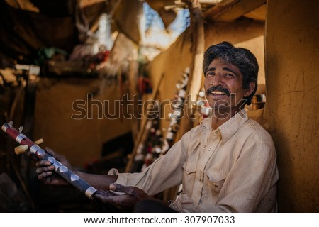 JAISALMER, INDIA - MARCH 22 : Indian man posing in the street on March 22, 2014 in Jaisalmer, India