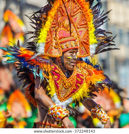 January 24th 2016. Iloilo, Philippines. Festival Dinagyang. Unidentified people on parade in carnival costumes. Documentary Editorial Image.
