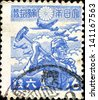 JAPAN - CIRCA 1943: A post stamp printed in Japan shows soldier with hammer, airplane, circa 1943 - stock photo