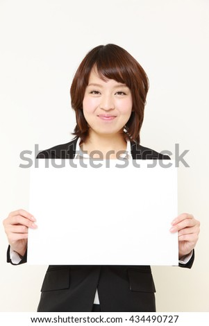Japanese businesswoman with message board