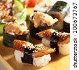 Japanese Cuisine - Eel Sushi Set. Nigiri and Gunkan Sushi with Maki Sushi and Sashimi - stock photo