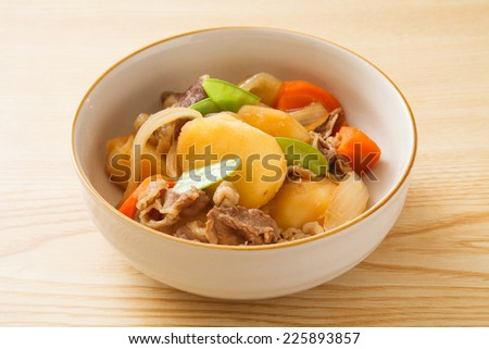 Japanese dish of boiled potatoes and pork