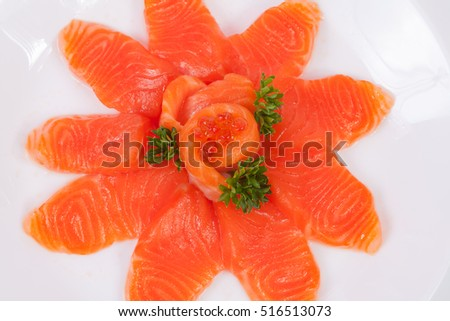 Japanese food salmon sashimi slices on a white plate, isolated white background.