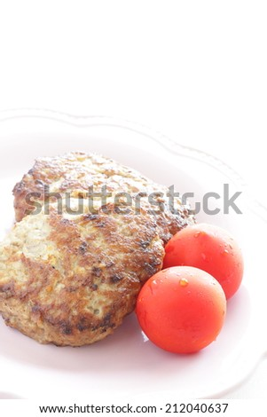 Japanese food, tofu hamburger with cherry tomato