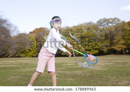 Japanese girl playing with a bubble