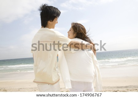 Japanese Man hugging Woman's shoulder