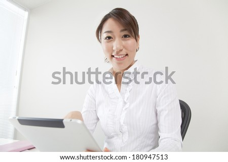 Japanese office lady using her tablet PC,
