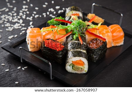 Japanese seafood sushi set on black stone background