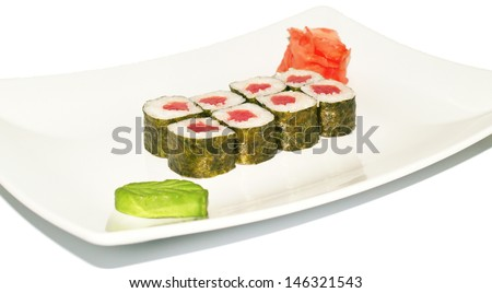 Japanese sushi rolls in plate on light background. Shallow DOF