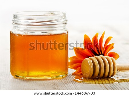 Jar of honey. Selective focus