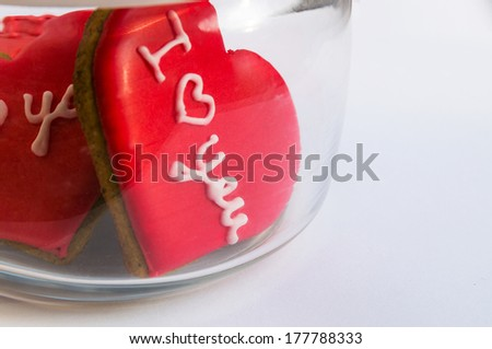 Jar with heart-shaped cookies close