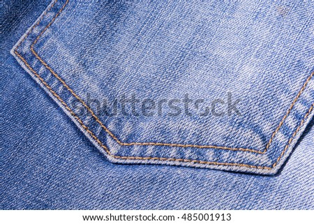 Jeans texture. Denim. The seam on the fabric.