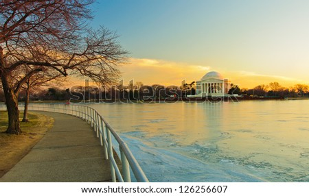 Jefferson Memorial and a frozen Potomac at sunset. Washington, DC
