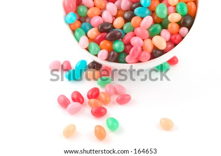 jelly beans spilling from a white bowl