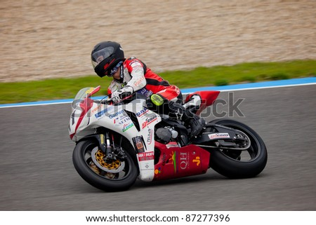 JEREZ DE LA FRONTERA, SPAIN - NOV 20: Stock Extreme motorcyclist Didac Fernandez takes a curve in the CEV championship on Nov 20, 2010, in Jerez de la Frontera, Spain