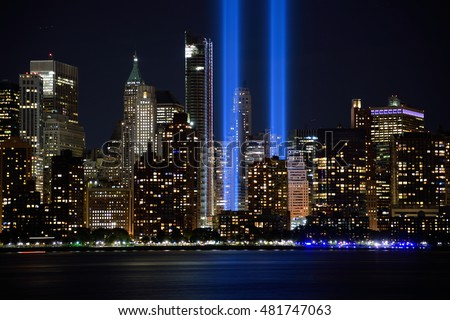 JERSEY CITY, NJ, USA - SEPTEMBER 11, 2016: The 9/11 Tribute in Lights temporary monument in lower Manhattan New York City marks the 15th anniversary of the terrorist attacks.