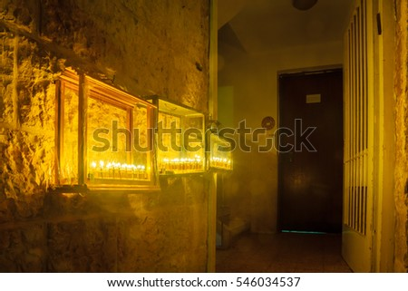 JERUSALEM, ISRAEL - DECEMBER 29, 2016: House entrance with a display of Traditional Menorahs (Hanukkah Lamps) with olive oil candles, in the Jewish quarter, Jerusalem Old City, Israel.