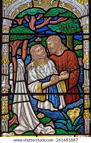 JERUSALEM, ISRAEL - MARCH 5, 2015: The baptism of Christ scene on the windowpane in st. George anglicans church from end of 19. cent.