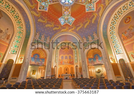 JERUSALEM, ISRAEL - MARCH 3, 2015: The main nave and modern cupola with the cross and mosaic in Church of St. Peter in Gallicantu.