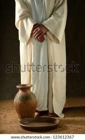 Jesus standing with his hands crossed and with a jar and bowl