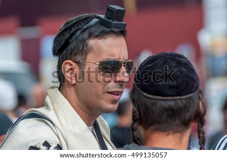 Jewish orthodox hasid wears, tefillin, tallit and kippah. Uman, Ukraine - 2 October 2016. Every year, thousands of Orthodox Hasidic Jews from different countries gather in Uman to mark Rosh Hashanah.