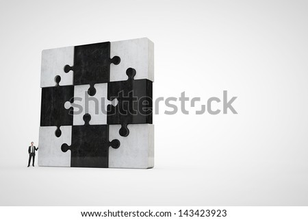 jigsaw puzzle and businessman