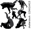 Jiu-Jitsu and Judo wrestlers silhouettes. Raster version. - stock photo
