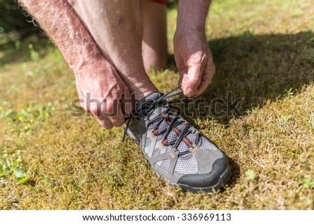Jogger tying his running shoes