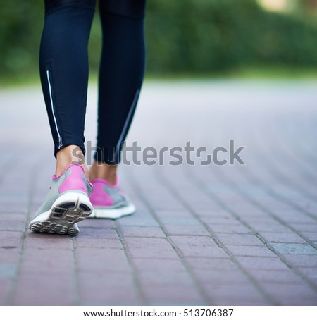Jogger walking in park