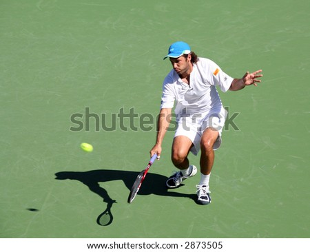 Jose Acasuso playing against Michail Youzhny at Pacific Life Open