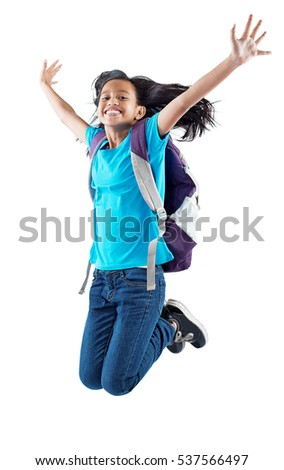 Joyful asian teenager jumping in the air. Isolated in white background.